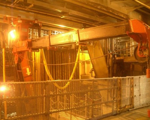 Rail mounted multipurpose crane